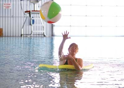 Ryan Williams/WGCN<br>  Williams Aquatic Center Coordinator Sherry Sleeper has a ball at the local pool, which will reopen to the public Tuesday.