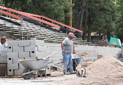 Ryan Williams/WGCN<br> Work is under way on a new retaining wall, which widens the WHS football field by approximately 25 feet.