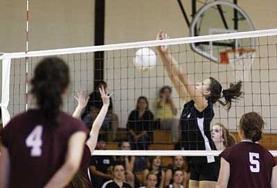 Ryan Williams/WGCN<br> A Lady Viking JV player attempts a block against Northland Prep Sept. 3.