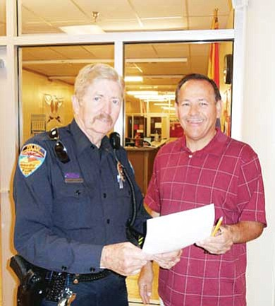 School Resource Officer Bob McCarty (left) is offering a $100 prize to the first eighth grade student who memorizes the seven articles of the U.S. Constitution. Pictured with McCarty is John Lechtenberger, sixth-eighth grade social studies teacher.