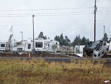 Photo/NAZ Today <br>  Damaged inventory at Camping World can be seen from Interstate 40.