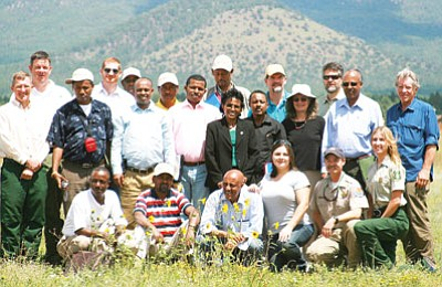 Photo/Tim Catlins<br> Kaibab National Forest officials pose with the 14-person Ethiopian delegation during a visit in August.