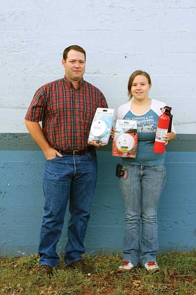Ryan Williams/WGCN<br> Williams Volunteer Fire Department Chief Jeff Dent and Safety Officer Nicole Raycraft display smoke detecters and  a fire extinguisher. Both items are available free to Williams residents.