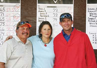 The winners of flight one — Sam Espinoza (left) and Andy Worthington — smile with Robynn Eckel, founder of SAVE-Meant to Rescue. SAVE hosted a golf tournament Oct. 10 at Elephant Rocks Golf Course as a fundraiser. The organization is working to care for stray dogs until a home can be found.
