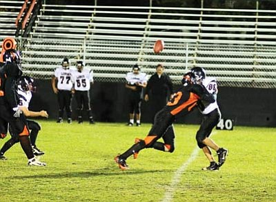 Ryan Williams/WGCN<br> The Vikings defense shakes up Many Farms' quarterback to force a fumble during their 61-0 win. The Vikings JV team entered the game with five minutes left in the first quarter.
