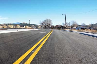 Ryan Williams/WGCN<br> Rodeo Road opened to vehicles Dec. 14 after three months of construction. Once named Morse Avenue, the roadway connects Airport Road to Grand Canyon Boulevard.