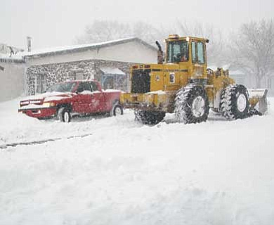 Lynda Duffy/WGCN <br>  City snowplows attempt to remove snow from roadways.