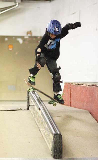 Ryan Williams/WGCN<br> Frankie Kramer grinds the rail at the Williams skate park.