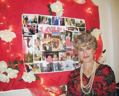 Photo/Judy Shimmel<br> Edith Pouquette stands in front of a wall of memories put together by her friends.