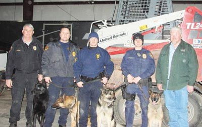 Submitted photo<br> Larry Pittenger (right) and Officer Brandon Hernandez (second from right) stand alongside Prescott Police Department and BNSF dog handlers.