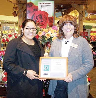 Submitted Photo<br>  Nareyda Norato, Williams, Elementary-Middle School PTSA President, presents a certificate of appreciation to Kandy Katsmiller, of Safeway.