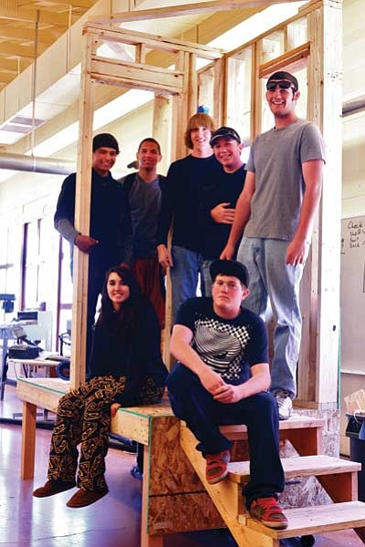 Ryan Williams/WGCN<br> The SkillsUSA team stands on a replica of the structure they built during competition. Pictured is Jimmy Perkins, Darius Brown, Terry Fuller, Trenton Lilly, Chase MacArthur, Wes Watson, Crystal Heiser. Not pictured are Dylan Mace, Hunter Carlson, Rhianna Hernandez and Cheyenne Lienhard.