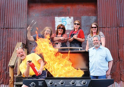Ryan Williams/WGCN<br> Northern Arizona Barbecue Festival Committee members get ready to grill in preparation for their second annual Kansas City Barbecue Society sancationed professional competition to be held July 1-3 in Williams. Pictured from left is Chuck Vaughn, Patti Williams, Sue Atkinson, Yvette Hudson, Brandi White and David Haines.