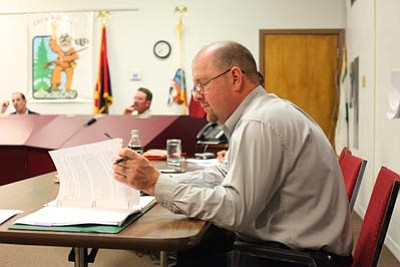 Ryan Williams/WGCN<br> City of Williams Finance Director Joe Duffy reviews a city ordinance at a recent Williams City Council meeting. Duffy, serving as Interim City Manager, has asked council to move forward with filling the manager position.