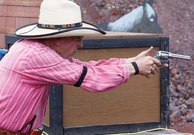 A contestant takes aim at last year's Railhead shooting competition held at the Williams Shooting Range.