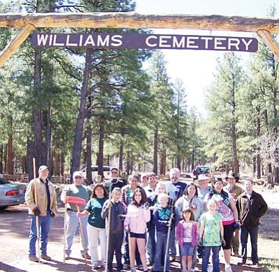 Photo/Todd Helgeson <br /><br /><!-- 1upcrlf2 --><br /><br /><!-- 1upcrlf2 --><br /><br /><!-- 1upcrlf2 -->The Williams Rotary Club and community members take a break after cleaning Williams Cemetery during last spring's cleanup day. Pictured are Rotarians Roxen Cureton, Bill Miller, Patricia Helgeson, Ken Lollich, Todd Yung, Anna Dick, Kevin Young, Gary McCarthy and Brian Prager; Multicultural Alliance Mexican Independence Day Royalty 2010 Queen Andrea Ayala and 2011 contestant Elena Gutierrez; Williams Girl Scout Troop No. 2616 members Jocelyn Ortega, Caitlyn Fritsinger, Madison Jensen, Cayla Fritsinger and Cassity Kearly and troop leaders Peggy Jensen and Michelle Bliss; and community volunteers Jim Jensen and Todd Helgeson.