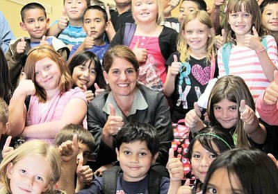 Ryan Williams/WGCN<br> Williams Elementary-Middle School Principal Rachel Savage celebrates the school's Performing Plus ranking with her elementary students.