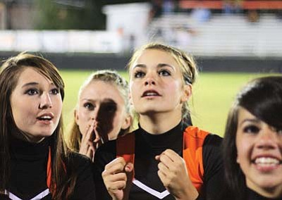 Ryan Williams/WGCN <br> Crystal Heiser (far left) and Jordan Pettit (center) shares a moment of suspense during last year's homecoming festivities.