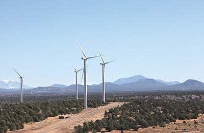 Ryan Williams/WGCN<br> Wind turbines stand at the ready against the backdrop of Bill Williams Mountain. In a month's time, 62 turbines in all will be operational at the Perrin Ranch Wind Farm off Highway 64 about 13 miles north of Williams.