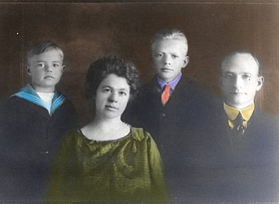Photo/Cureton Family Collection<br> The Cureton family poses in 1919 for a photo. Pictured from left are Carl Cureton, Nellie King, Miles Cureton and Thomas Henry Cureton.