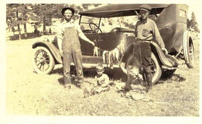 Photo/Thurston Family Collection <br> Bob Thurston proudly displays fish the family caught at Lake Mary in 1924.