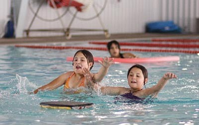 Ryan Williams/WGCN<br> Children enjoy the cool of the pool at the Williams Aquatic Center.