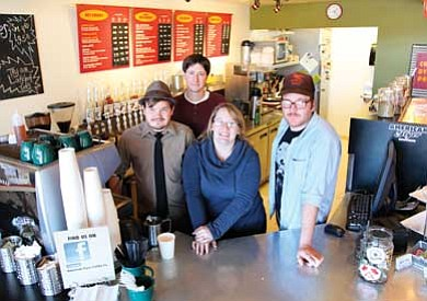 From left, Barista Luke Messina, new owners Eric and Donya Hadder and Barista Jeff Wright stand behind American Flyer Coffee Co. espresso bar. The Hadders recently took ownership of the shop.