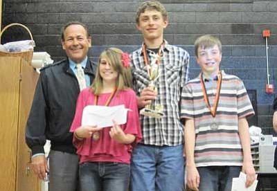 Submitted Photo <br> John Lechtenberger (left) awards the Social Studies Knowledge Bowl winners, Katie Ellico, Andrew Karlsberger and Braden Heap.