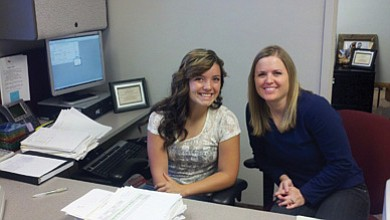 Devin McNelly and Jennifer Carter take a break from their work to pose for a picture.