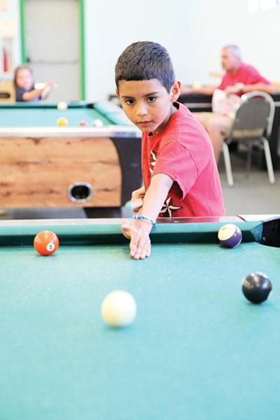 Raul Velasquez, age 9, enjoys a game of pool at the Williams Recreation Center. Ryan Williams/WGCN