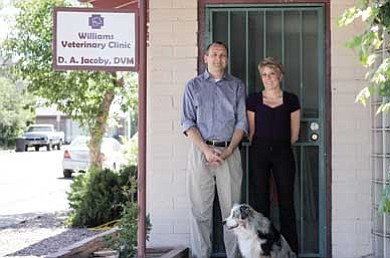 Dr. Daniel Jacoby and Traci Fulkerson stand in front of their new veterinarian office located at 122 S. Third St. in Williams. David Yankus/WGCN