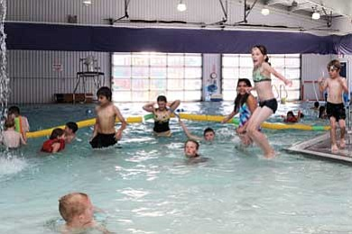 A young diving enthusiast leaps into the pool. An additional 50 people can now take advantage of free swimming lessons this summer thanks to the Greater Williams Community Fund. Ryan Williams/WGCN