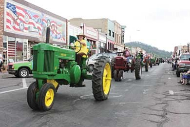 Northern Arizona Antique Tractor and Engine Association members head down Route 66 during last year's Fourth of July parade. The tractors will again make an appearance during this year's festivities. Clara Beard/WGCN