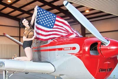 Happy Independence Day! Miss Kathleen Raye on her father's (Walt Eastland)1947 Beechcraft Bonanza V-tail Aircraft at the Williams Clark Memorial Airport. Photo/Saaty Photography