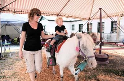 Milo Williams enjoys a ride on Missy the pony as mom Jessica looks on during last year's county fair. Ryan Williams/WGCN