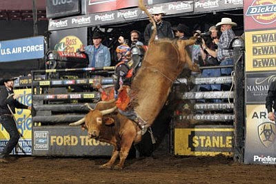 Austin Meier rides The Game Changer for 90.25 points during R3 of the Springfiled BFTS PBR. Photo/Andy Watson/PBR