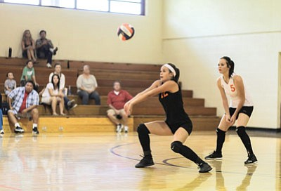 Jordan Pettit bumps a hard Greyhills serve as Jessie Durnez looks on during the Lady Vikes loss Sept. 6. Ryan Williams/WGCN<br /><br /><!-- 1upcrlf2 -->
