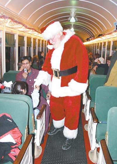 Santa makes his way through the Polar Express train greeting young and old at heart. Photo/WGCN