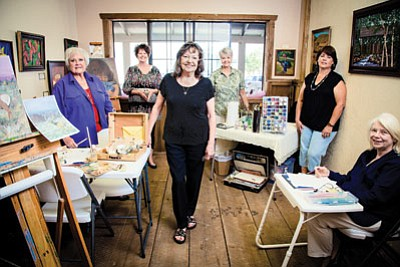 Local artists gather around Helen Gorney (center) at the Open Studio, 106 S. Ninth St. The studio is open 10 a.m.-6 p.m. Thursday through Sunday. Everyone is invited to celebrate the studio's grand opening 5-8 p.m. Saturday. Ryan Williams/WGCN