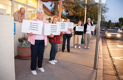 Ruth Sanzari (left) and others protest in front of Williams City Hall before the Sept. 20 Planning and Zoning meeting concerning a conditional use permit for a medical marijuana dispensary located on Route 66. Ryan Williams/WGCN