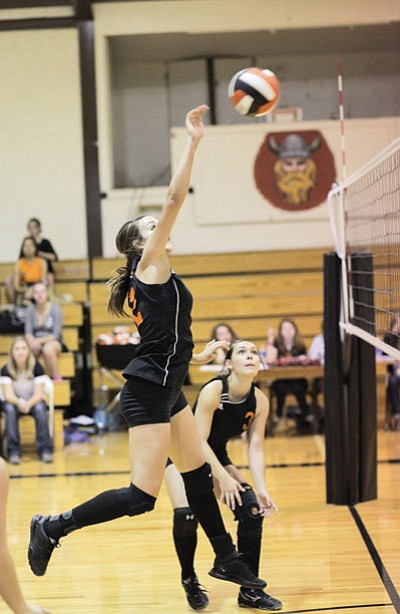 Jordan Pettit gets above the net to score in a recent Lady Vikes game. Ryan Williams/WGCN
