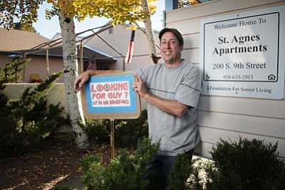 Guy Mikkelsen stands in front of St. Agnes Apartments. Mikkelsen has managed the apartments for 20 years. Ryan Williams/WGCN