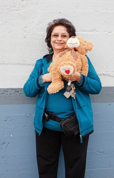 Virginia Quinn displays a Curly the Bear stuffed animal.  The Williams Kiwanis Club will give close to 200 bears to children who attend the Williams Community Holiday Dinner Dec. 16 at Doc Holliday's restaurant. Ryan Williams/WGCN