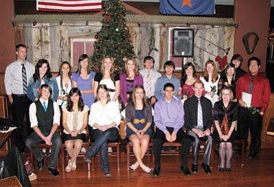 Williams High School Chapter of the National Honor Society inducted 12 new members at their annual induction dinner Dec. 5 at Doc Holliday's Steakhouse. Junior and senior students who demonstrate a high level of service, leadership, character, and scholarship are selected to join this prestigious group. Front row from left: Ethan Reinarz, Sylvia Cardenas, Allison Garver, Cheyenne Lienhard, Oscar Nunez, Austin Garlington and Ann Wells, sponsor. Back row from left: Williams High School Principal Tristan Heisley, Jessie Durnez, Ximena Hernandez, Chanell MacRae, April Zicopoulos, Karrina Rotter, Jeff Ellico, Colton Grantham, Devin McNelly, Miranda Mann, Breanna Chester, Zach Tamburllo and Shean Ponce. Doug Wells/WGCN