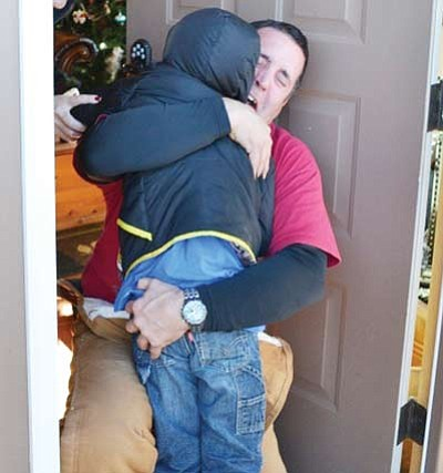 Evans is reunited with his father. Submitted photo