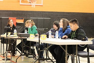 Rheanon Koss (second from right) thinks hard on her way to a first place finish in the social studies category of the Williams Middle School Knowledge Bowl Jan. 15. David Yankus/WGCN