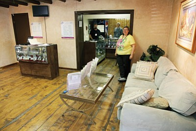 Patricia Wuensche, vice president of Route 66 Wellness Center, stands inside the medical marijuana dispensary. The dispensary opened for business last month.  Ryan Williams/WGCN