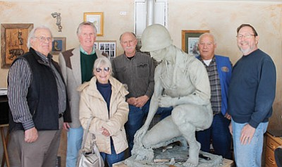 Kiwanis members Bill Miller, Roger Ely, Carol Glassburn, artist Neil Logan, Bud Parenteau and Bob Grinnell stand with the Williams Own Veterans Memorial Jan. 30. Marissa Freireich/WGCN