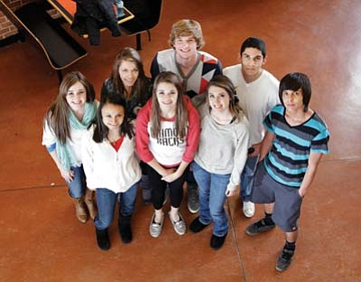 From left to right: Bayleigh Preston, Diana Hernandez, Cheyenne Lienhard, Jordan Pettit, Jeff Brownlee, Crystal Heiser, Oscar Nunez, and Steve Ortiz stand in the Williams High School lobby. Ryan Williams/WGCN