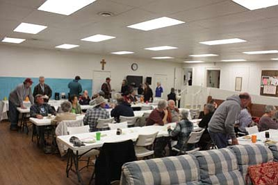 Williams community members and residents enjoy each others' company while eating pancakes and sausage. David Yankus/WGCN